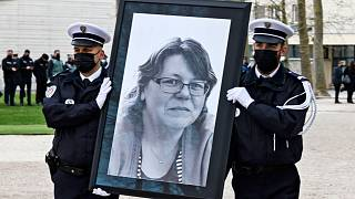 French police officers carry the portrait of Stephanie Monferme during the remembrance gathering in Rambouillet.