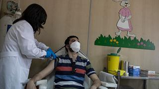 36 year-old Vasilis Tsipiras receives his first dose of the of the AstraZeneca COVID-19 vaccine, at a vaccination center in Piraeus, near Athens, April 29, 2021.