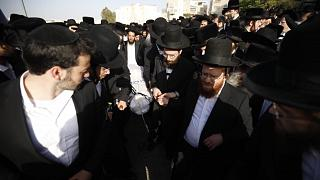 Mourners carry the body of Yhuda Libe Rubin, who died during Lag BaOmer celebrations