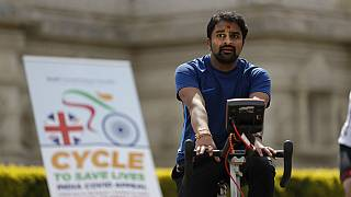 """A man takes part in """"Cycle to Save Lives"""" a 48 hour, non-stop static relay cycle challenge at the Neasden Temple in north London to raise money for relief efforts in India.fo"""