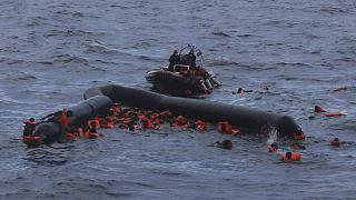 In this Wednesday, Nov. 11, 2020 file photo, refugees and migrants are rescued by members of the Spanish NGO Proactiva Open Arms, after leaving Libya trying to reach Europe.