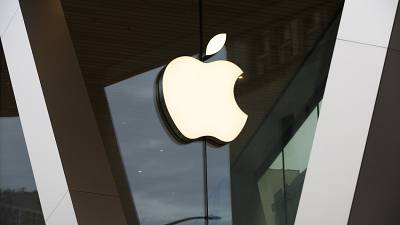 FILE - In this Saturday, March 14, 2020 file photo, an Apple logo adorns the facade of the downtown Brooklyn Apple store in New York.