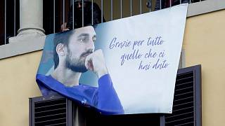 Supporters display a poster during the funeral ceremony of Davide Astori in Florence in March 2018.