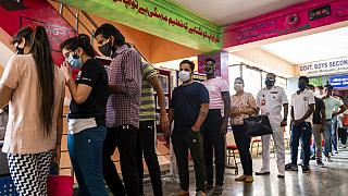 People line up to get the Covid-19 coronavirus vaccine in a school-turned-vaccination centre in New Delhi on May 3, 2021.