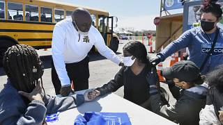 A East Hartford High School senior receives the first dose of the Pfizer vaccine to Pryce at a mass vaccination site in East Hartford, Conn., April 26, 2021.