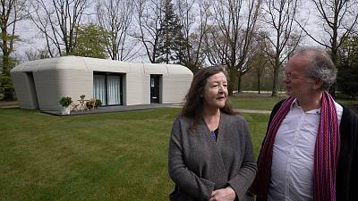 Tenants Elize Lutz and Harrie Dekkers in front of their new home.