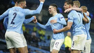 Manchester City's Riyad Mahrez celebrates with teammates after scoring his second goal in the Champions League semifinal match against PSG.