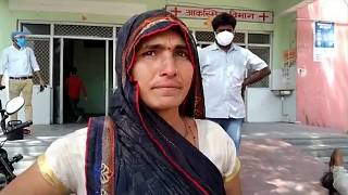 Woman crying outside hospital