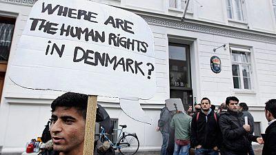 Syrian refugees hold banners outside the Swedish Embassy in Copenhagen, Denmark on Wednesday, 26 September, 2012.