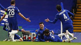 Chelsea's Mason Mount, centre, celebrates with his teammates after scoring his side's second goal,