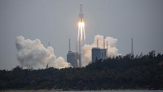 China says most rocket debris burned up during re-entry