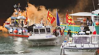 Fishing vessels at sea off the coast of Jersey, Thursday, May 6, 2021. French fishermen angry over loss of access to waters off their coast have gathered their boats in protes