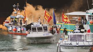 Fishing vessels at sea off the coast of Jersey, Thursday, May 6, 2021. French fishermen angry over loss of access to waters off their coast have gathered their boats.