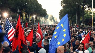 In this Saturday, May 25, 2019 file photo, protesters take part in an anti-government rally, demanding the resignation of the Socialist Prime Minister Edi Rama, in Tirana.