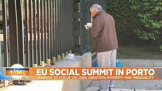 Man eats outside a gate in Porto, Portugal