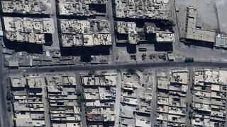This satellite image shows road damage and craters, in the Sha'ar district of Aleppo, Syria, Sept. 18, 2016.
