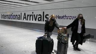 In this Jan. 17, 2021 file photo travelers arrive at Heathrow Airport in London