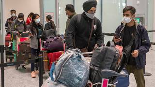 Passengers from New Delhi wait in long lines for COVID19 testing