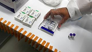 A medical worker prepares vials of the COVID-19 vaccines, Chinese Sinopharm, left, Sputnik V, center, and Pfizer at a vaccine centre, in the Usce shopping mall in Belgrade.