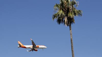 FILE - In this Aug. 21, 2019 file photo, an easyJet airplane approaches Lisbon airport for landing.