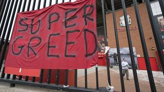 In this file photo dated Wednesday, April 21, 2021, a protest banner against the proposed Super League is seen outside Liverpool's Anfield Stadium