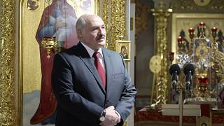 Belarusian President Alexander Lukashenko, left, attends the Orthodox Easter service in the town of Turov, some 270 km (167 miles) south of Minsk, Belarus, Sunday, May 2, 2021