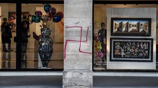 FILE: A picture shows a swastika spray painted on a column of the Rivoli street in central Paris on October 11, 2020.