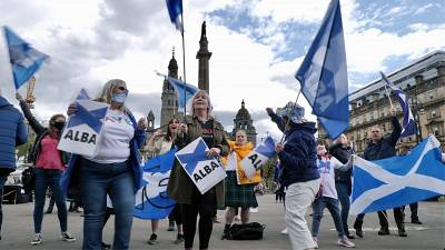 FILE PHOTO: Scottish independence supporters attend a rally in Glasgow, Scotland, Saturday, May 1, 2021.