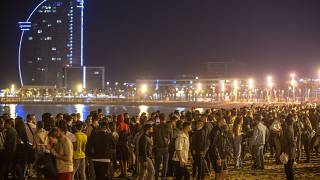 People crowded on the beach in Barcelona, Spain, Sunday, May 9, 2021.