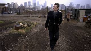 architect Helmut Jahn walks through a vacant lot on Chicago's near north side.