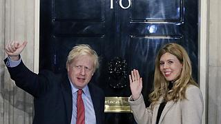 Boris Johnson and his partner Carrie Symonds wave from the steps of number 10 Downing Street (Dec 2019)