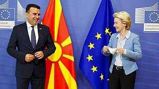European Commission President Ursula von der Leyen and North Macedonia's Prime Minister Zoran Zaev pose for photographers at EU headquarters in Brussels