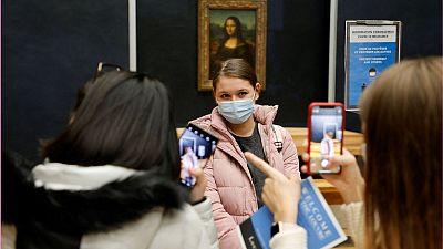 Students stood by Da Vinci's great masterpiece, the Mona Lisa