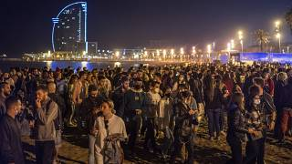 People crowded on the beach in Barcelona, Spain, Sunday, May 9, 2021. Barcelona residents were euphoric as the clock stroke midnight, ending a six-month state of emergency.