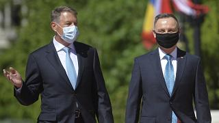Polish President Andrzej Duda, right, reviews the honor guard with Romanian President Klaus Iohannis during the welcoming ceremony at the Cotroceni presidential palace.