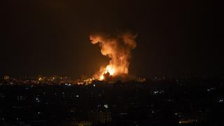 An explosion caused by Israeli airstrikes on the Gaza Strip is seen early Tuesday, May 11, 2021.