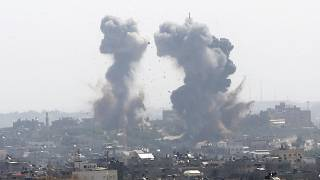 دخان يتصاعد بعد غارة إسرائيلية لقطاع غزة، مايو، 2021.