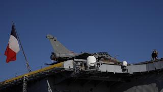 Nuclear-powered aircraft carrier Charles de Gaulle with with a French flag at Limassol port, Cyprus