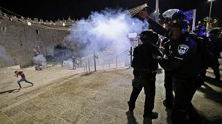 Israeli security forces disperse people from Jerusalem's Damascus Gate.