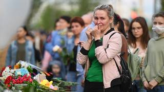 A woman reacts at a makeshift memorial for victims of the shooting at School No. 175 in Kazan.