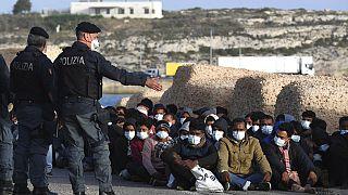 Migrantes em Lampedusa