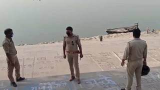 This frame grab from video provided by KK Productions shows police officials stand guard at the banks of the river where several bodies were found lying in Ghazipur district.