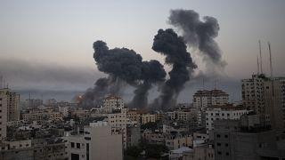 Smoke rises after Israeli airstrikes on Gaza City, Wednesday, May 12, 2021.