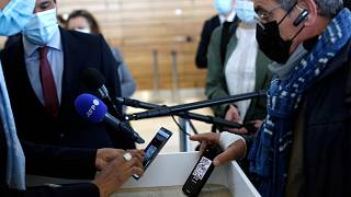 A passenger shows his mobile phone with an uploaded antigen and PCR test prior to board at the Paris-Orly airport, in Orly, south of Paris,  April 27, 2021.