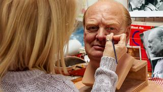 Sue Day hand paints every tiny detail on Winston Churchill's face