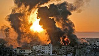 A fire rages at sunrise in Khan Yunish following an Israeli airstrike.