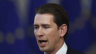 FILE: Austrian Chancellor Sebastian Kurz speaks with the media as he arrives for an EU summit in Brussels, Thursday, March 21, 2019.
