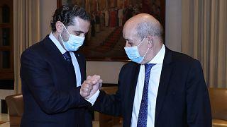 وزير الخارجية الفرنسي لودريان ورئيس الحكومة اللبنانية السابق سعد الحريري