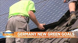 Solar panels being assembled on rooftop.