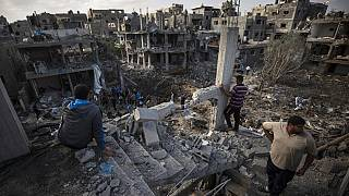 Palestinians view their destroyed houses in the town of Beit Hanoun on the northern Gaza Strip after intense bombardment on Thursday night
